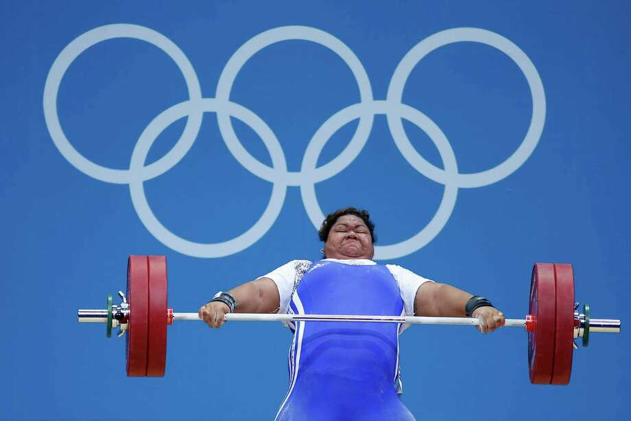 Ele Opeloge of Samoa competes during the Women's 75kg Weightlifting. Photo: Jamie Squire, Getty Images / 2012 Getty Images