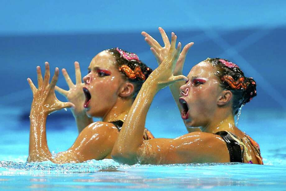 Sara Labrousse and Chloe Willhelm of France compete in the Women's Duets Synchronised Swimming Technical Routine at the Aquatics Centre  in London. Photo: Al Bello, Getty Images / 2012 Getty Images