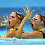 Sara Labrousse and Chloe Willhelm of France compete in the Women's Duets Synchronised Swimming Technical Routine at the Aquatics Centre  in London.