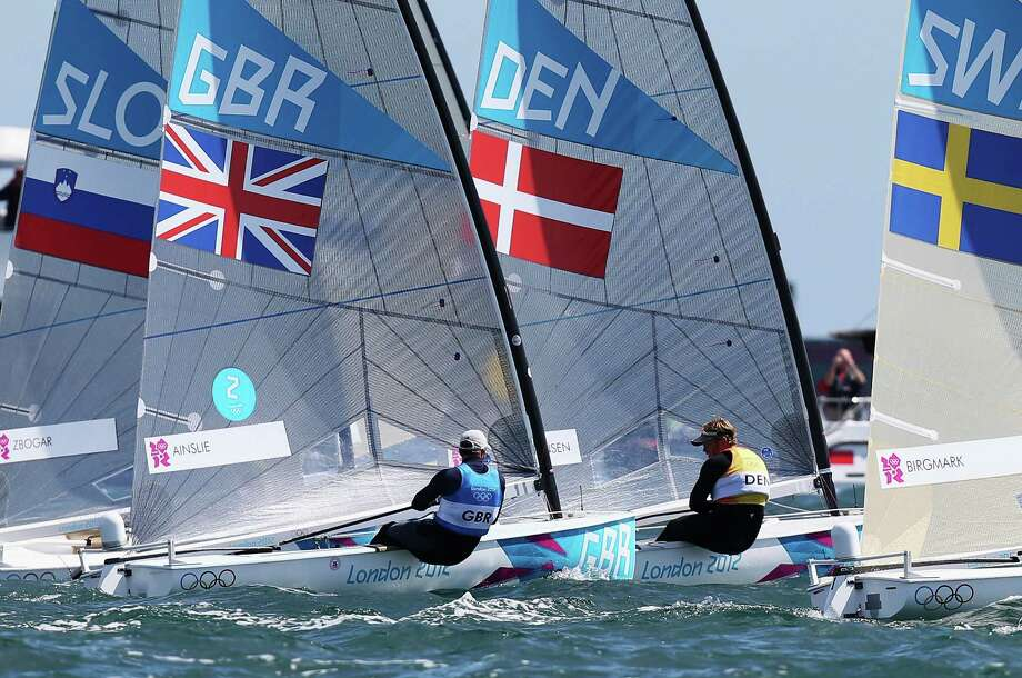 Ben Ainslie (L) of Great Britain and Jonas Hogh-Christensen (R) of Denmark shadow one another at the start of the Men's Finn Sailing Medal Race. Photo: Clive Mason, Getty Images / 2012 Getty Images