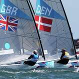 Ben Ainslie (L) of Great Britain and Jonas Hogh-Christensen (R) of Denmark shadow one another at the start of the Men's Finn Sailing Medal Race.