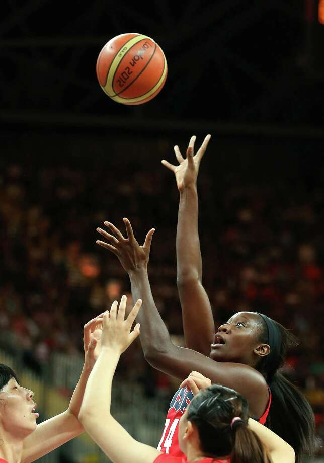 Tina Charles #14 of United States puts up a shot against China during the Women's Basketball Preliminary Round match. Photo: Christian Petersen, Getty Images / 2012 Getty Images
