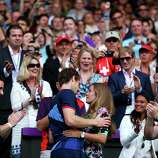 Andy Murray (L) of Great Britain celebrates with his girlfriend Kim Sears after defeating Roger Federer of Switzerland in the Men's Singles Tennis Gold Medal Match.
