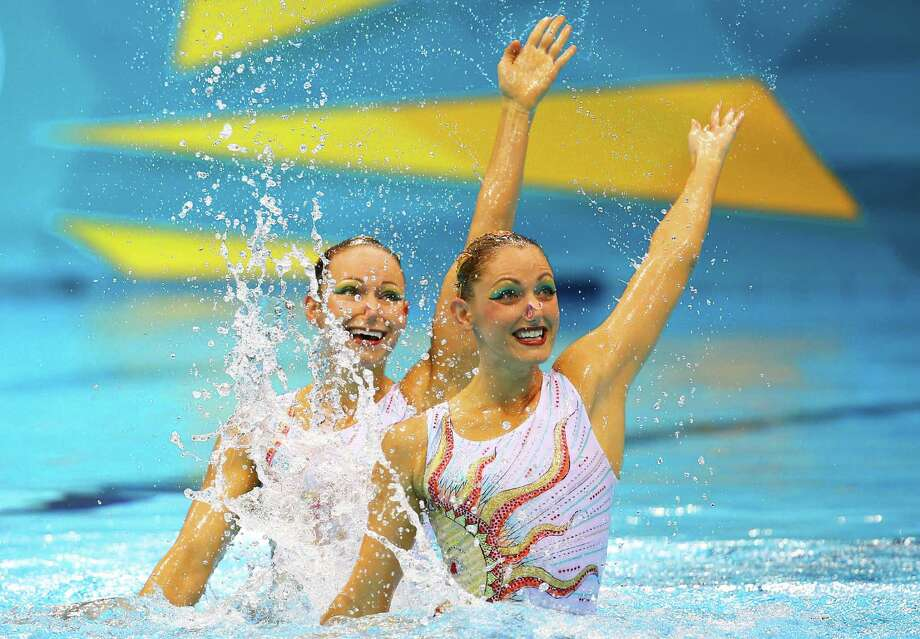Eloise Amberger and Sarah Bombell of Australia compete in the Women's Duets Synchronised Swimming Technical Routine at the Aquatics Centre  in London. Photo: Al Bello, Getty Images / 2012 Getty Images