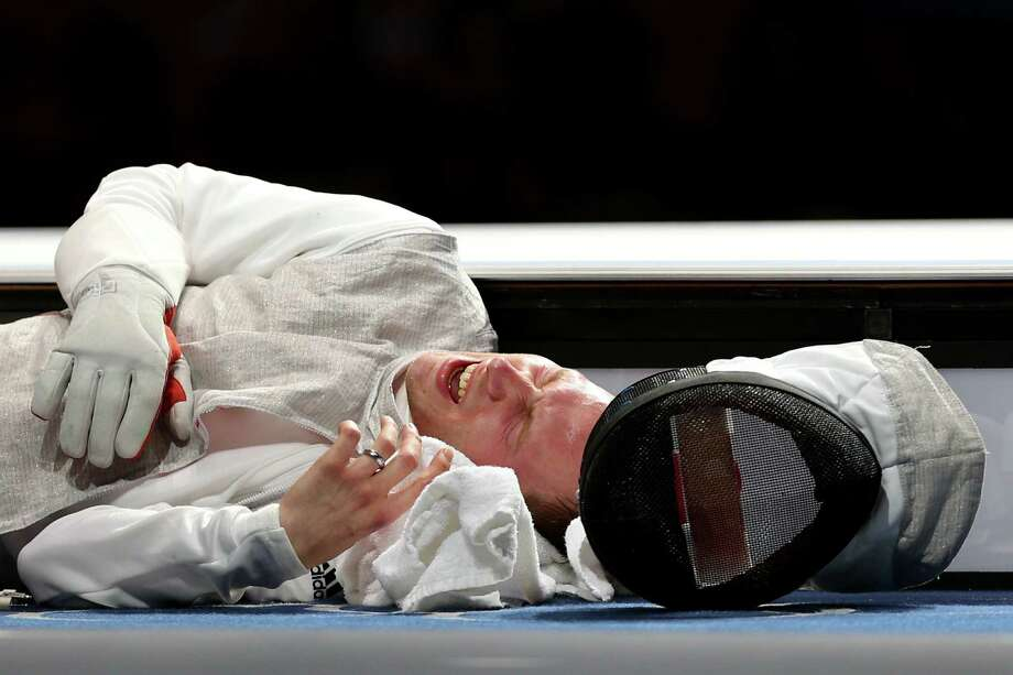 Sebastian Bachmann of Germany reacts to an injury sustained while competing against Gerek Meinhardt of the United States in the bronze medal match for the Men's Foil Team Fencing finals. Photo: Hannah Johnston, Getty Images / 2012 Getty Images