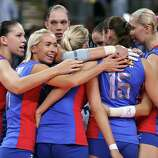 Russia celebrates the match win over Italy during Women's Volleyball at Earls Court in London.