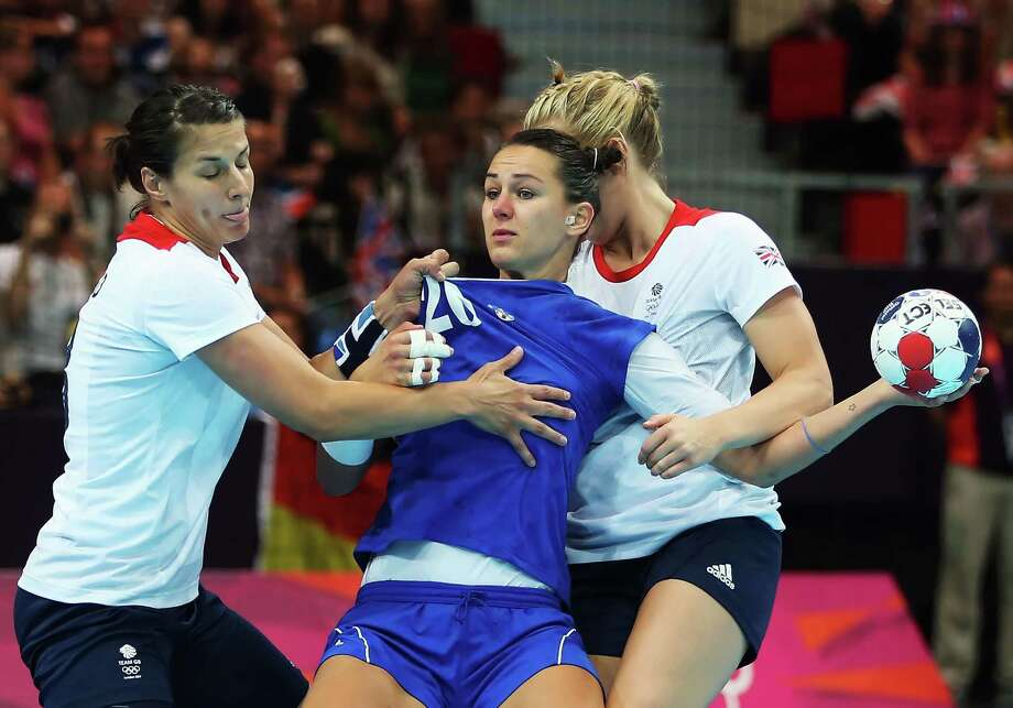 Vesna Milanovic-Litre (center) #20 of Croatia is tied up by Yvonne Leuthold (L) #13 and Nina Heglund (R) #5 of Great Britain during the Women's Handball Preliminaries Group A match between Great Britain and Croatia at the Copper Box in London. Photo: Jeff Gross, Getty Images / 2012 Getty Images