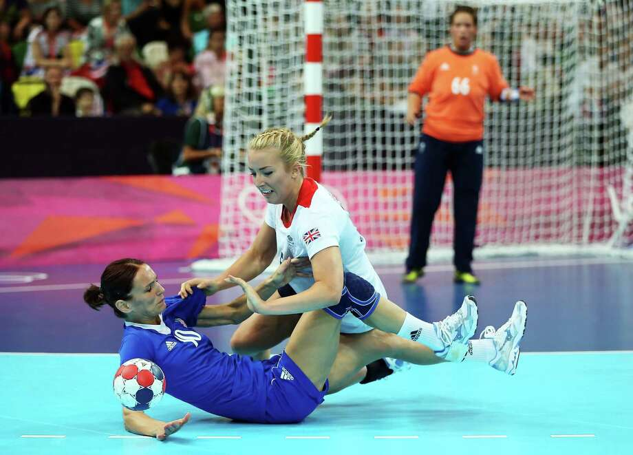 Nikica Pusic-Koroljevic (L) #10 of Croatia is tackled by Nina Heglund #5 of Great Britain during the Women's Handball Preliminaries Group A match between Great Britain and Croatia at the Copper Box in London. Photo: Jeff Gross, Getty Images / 2012 Getty Images