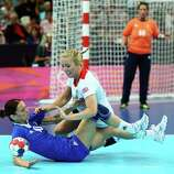 Nikica Pusic-Koroljevic (L) #10 of Croatia is tackled by Nina Heglund #5 of Great Britain during the Women's Handball Preliminaries Group A match between Great Britain and Croatia at the Copper Box in London.