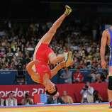Mingiyan Semenov of Russia celebrates winning his Men's Greco-Roman 55 kg Wrestling Bronze Medal bout against Gyujin Choi of Korea.