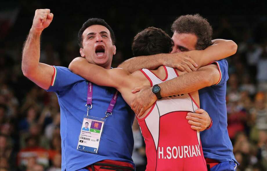 Hamid Mohammad Soryan Reihanpour of Islamic Republic of Iran celebrates winning his Men's Greco-Roman 55 kg Wrestling Gold Medal bout against Rovshan Bayramov of Azerbaijan with his Coaches. Photo: Scott Heavey, Getty Images / 2012 Getty Images