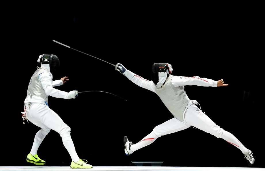 (L-R) Yuki Ota of Japan competes against Giorgio Avola of Italy in the gold medal match of the Men's Foil Team Fencing finals. Photo: Lars Baron, Getty Images / 2012 Getty Images