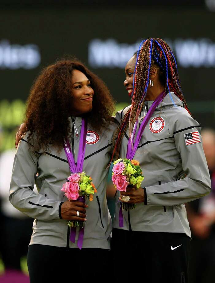 Gold medalists Serena Williams of the United States and Venus Williams of the United States celebrate on the podium during the medal ceremony for the Women's Doubles Tennis. Photo: Paul Gilham, Getty Images / 2012 Getty Images