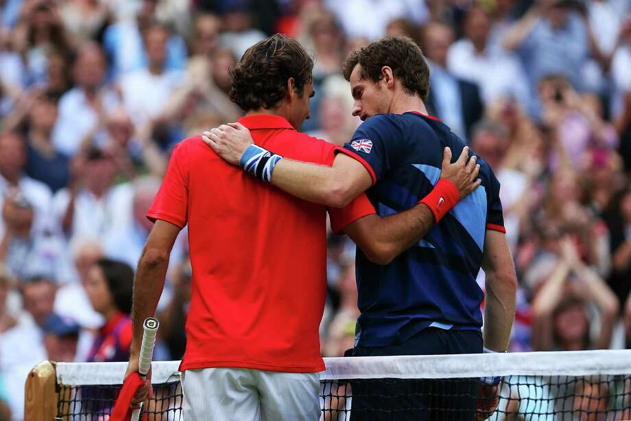Andy Murray of Great Britain speaks with Roger Federer of Switzerland at the net after the Men's Singles Tennis Gold Medal Match. Photo: Clive Brunskill, Getty Images / 2012 Getty Images