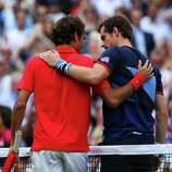 Andy Murray of Great Britain speaks with Roger Federer of Switzerland at the net after the Men's Singles Tennis Gold Medal Match.