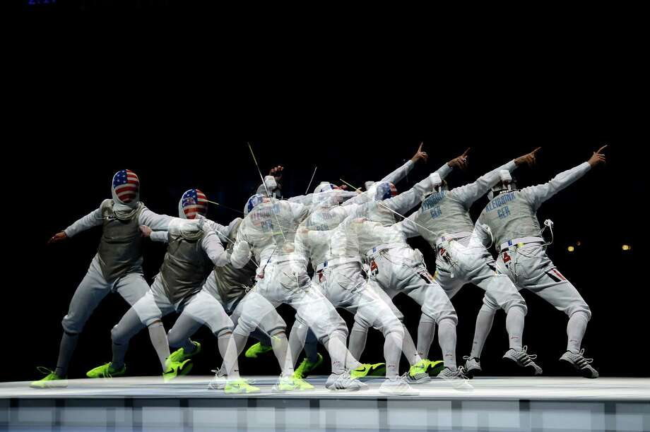 (Multiple exposures were combined in camera to produce this image.) (L-R) Race Imboden of the United States competes against Benjamin Kleibrink of Germany in the bronze medal match for the Men's Foil Team Fencing finals. Photo: Lars Baron, Getty Images / 2012 Getty Images