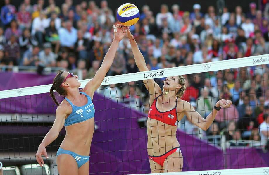 Kerri Walsh Jennings of the United States contests the ball against Greta Cicolari of Italy during the Women's Beach Volleyball Quarter Final match between United States and Italy at Horse Guards Parade in London. Photo: Ryan Pierse, Getty Images / 2012 Getty Images