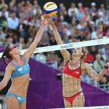 Kerri Walsh Jennings of the United States contests the ball against Greta Cicolari of Italy during the Women's Beach Volleyball Quarter Final match between United States and Italy at Horse Guards Parade in London.