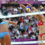 Kerri Walsh Jennings of the United States blocks Marta Menegatti of Italy during the Women's Beach Volleyball Quarter Final match between United States and Italy.