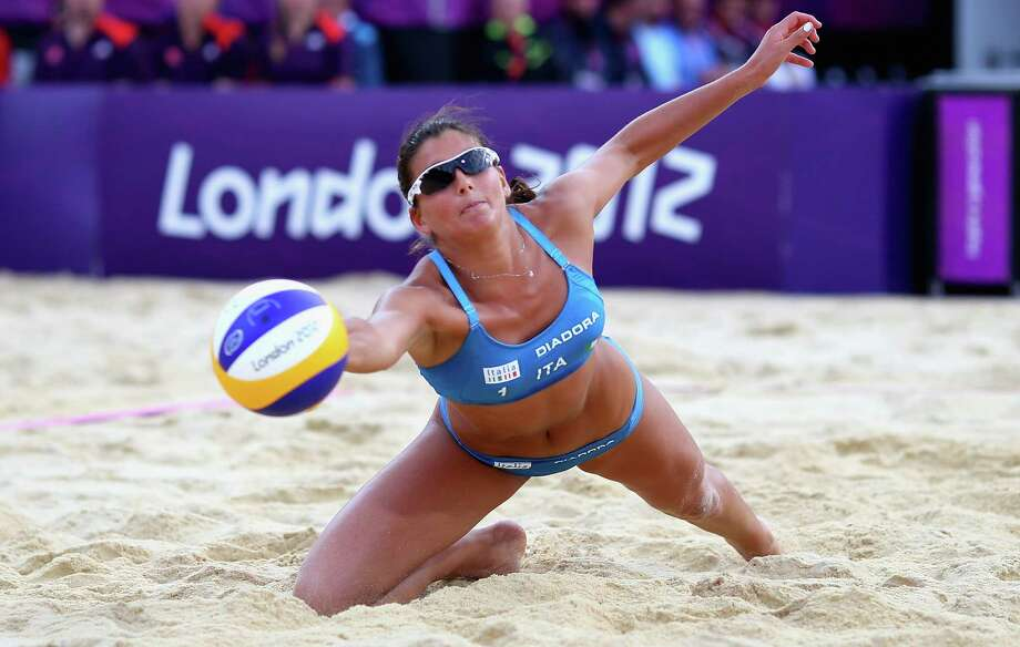 Marta Menegatti of Italy dives for tha ball during the Women's Beach Volleyball Quarter Final match between United States and Italy. Photo: Ryan Pierse, Getty Images / 2012 Getty Images