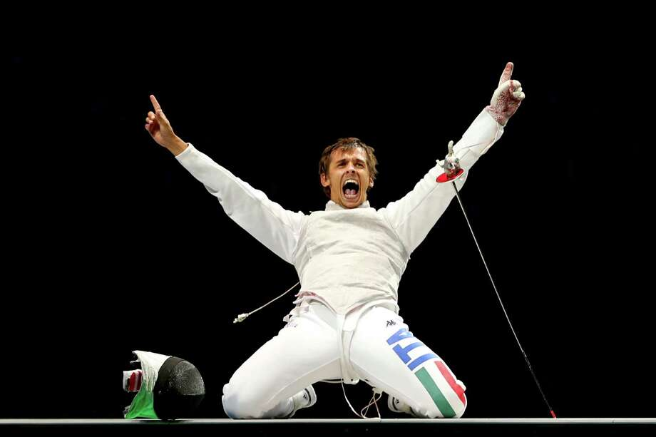 Andrea Baldini of Italy celebrates defeating Yuki Ota of Japan to win the gold medal match 45-39 in the Men's Foil Team Fencing finals. Photo: Hannah Johnston, Getty Images / 2012 Getty Images