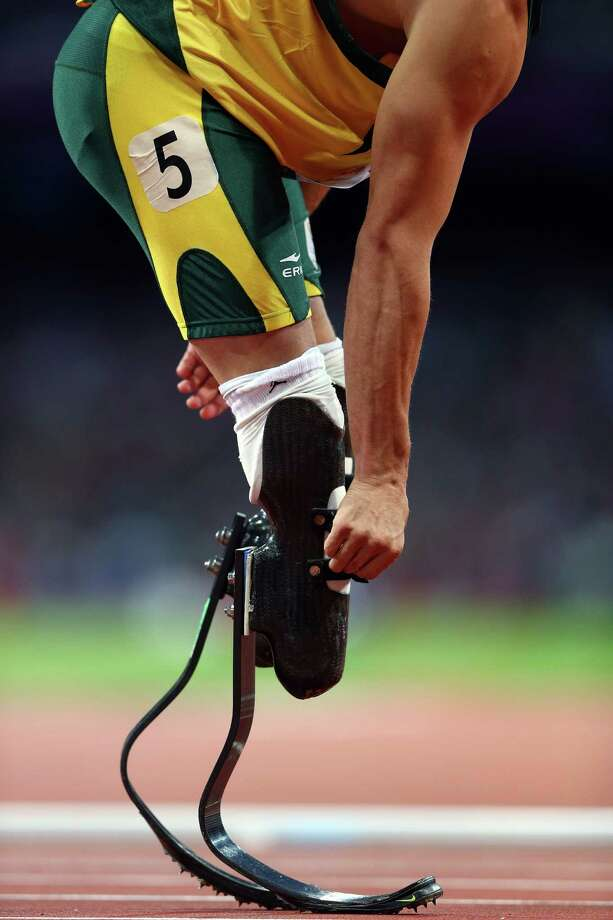 Oscar Pistorius of South Africa competes in the Men's 400m Semi Final. Photo: Michael Steele, Getty Images / 2012 Getty Images