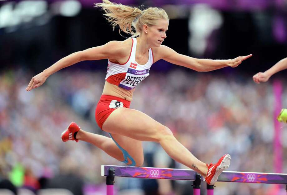 Sara Petersen of Denmark competes in the Women's 400m Hurdles Heat. Photo: Mike Hewitt, Getty Images / 2012 Getty Images