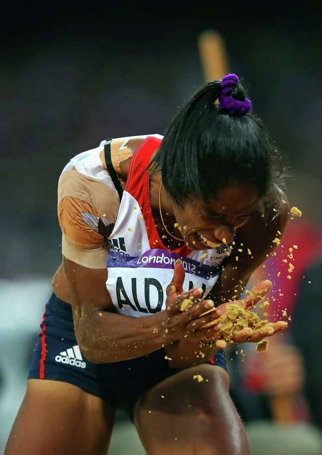 Yamile Aldama of Great Britain reacts in the Women's Triple Jump Final. Photo: Alexander Hassenstein, Getty Images / 2012 Getty Images