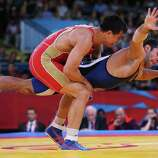 Roman Vlasov of Russia (L) competes against Arsen Julfalakyan of Armenia during their Men's Greco-Roman 74 kg Wrestling Gold Medal bout.