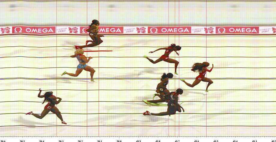 In this handout photo finish image supplied by Omega,  Sanya Richards-Ross of the United States crosses the finish line to win the Women's 400m final. Photo: Handout, Getty Images / 2012 Omega