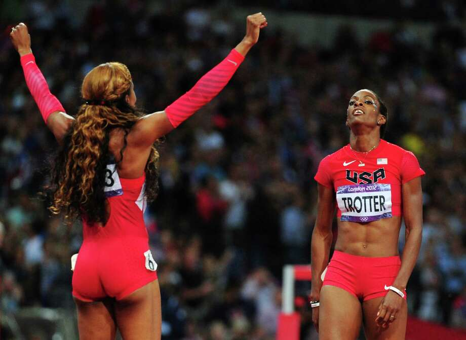 Gold medalist Sanya Richards-Ross of the United States celebrates with bronze medalist DeeDee Trotter of the United States in the Women's 400m Final. Photo: Stu Forster, Getty Images / 2012 Getty Images