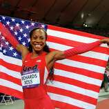 Sanya Richards-Ross of the United States celebrates winning gold in the Women's 400m Final.
