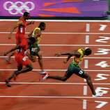 Usain Bolt of Jamaica  crosses he line to win gold in the Men's 100m Final at the Olympic Stadium in London.