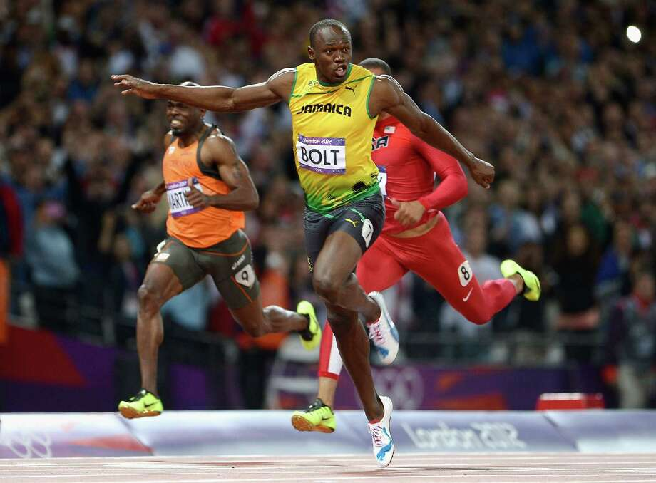 Usain Bolt of Jamaica crosses the finish line to win the gold medal in the Men's 100m Final. Photo: Pascal Le Segretain, Getty Images / 2012 Getty Images
