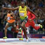 Usain Bolt of Jamaica crosses the finish line to win the gold medal in the Men's 100m Final.
