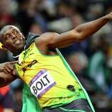 Usain Bolt of Jamaica celebrates after crossing the finish line to win the gold medal in the Men's 100m Final.