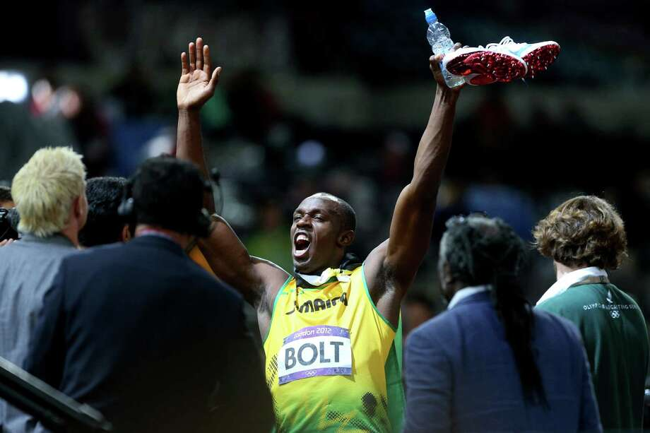 Usain Bolt of Jamaica celebrates after winning the gold medal in the Men's 100m Final. Photo: Cameron Spencer, Getty Images / 2012 Getty Images