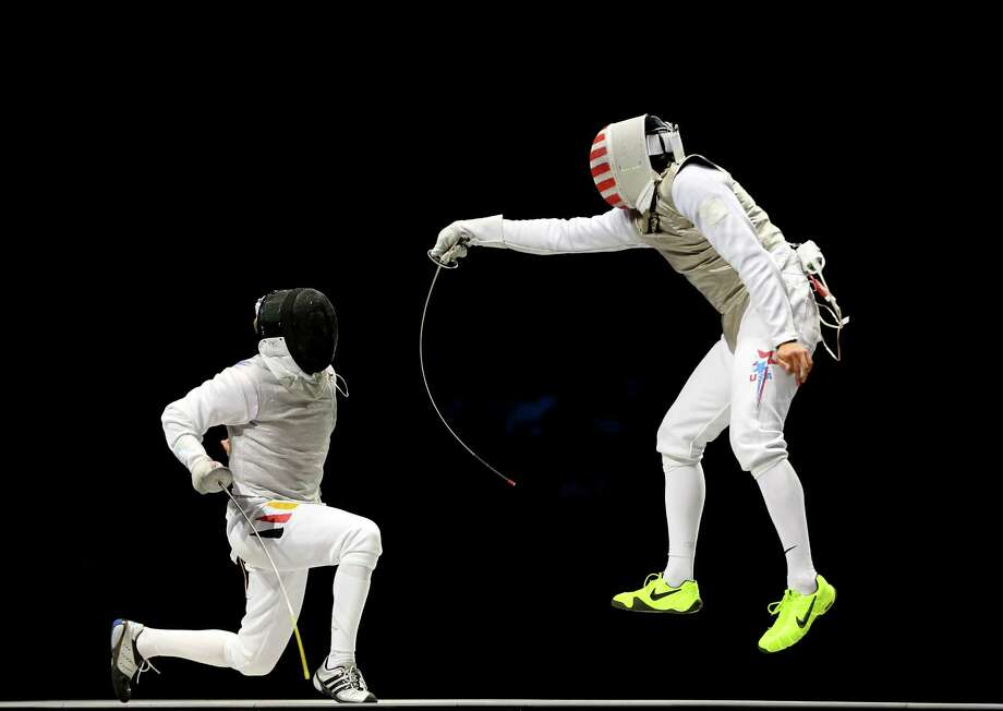 Gerek Meinhardt (R) of the United States competes against Peter Joppich (L) of Germany in the bronze medal match for the Men's Foil Team Fencing finals. Photo: Hannah Johnston, Getty Images / 2012 Getty Images