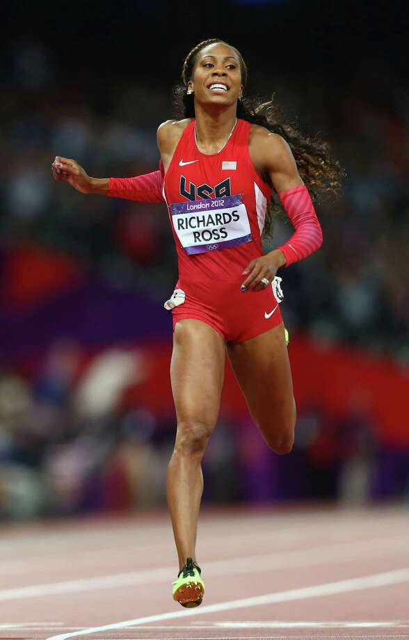 Sanya Richards-Ross of the United States crosses the line to win gold in the Women's 400m Final. Photo: Michael Steele, Getty Images / 2012 Getty Images