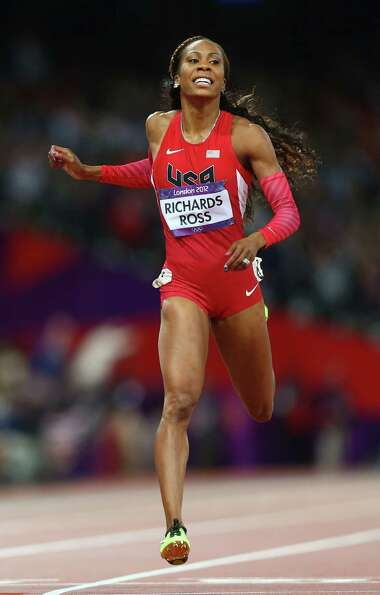Sanya Richards-Ross of the United States crosses the line to win gold in the Women's 400m Final.