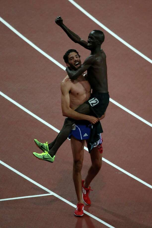 Gold medalist Ezekiel Kemboi of Kenya celebrates with the silver medalist Mahiedine Mekhissi-Benabbad of France after the Men's 3000m Steeplechase Final. Photo: Jeff J Mitchell, Getty Images / 2012 Getty Images