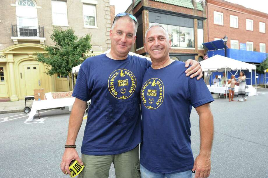 Greenwich police Sgt. Jim Bonney, president of the Greenwich Police Police Silver Shield, with Greenwich police officer Bob Ferretti at the annual Greenwich Avenue Block Party at lower Greenwich Avenue Sunday, Aug. 5, 2012. The party was hosted by the Greenwich Police Silver Shield Association, in partnership with the First Bank of Greenwich and J House. Photo: Helen Neafsey / Greenwich Time
