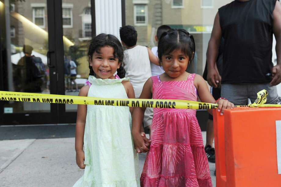 Jessica Quechal, 4, and Anet Campas, 5, of Greenwich at the annual Greenwich Avenue Block Party at lower Greenwich Avenue Sunday, Aug. 5, 2012. The party was hosted by the Greenwich Police Silver Shield Association, in partnership with the First Bank of Greenwich and J House. Photo: Helen Neafsey / Greenwich Time
