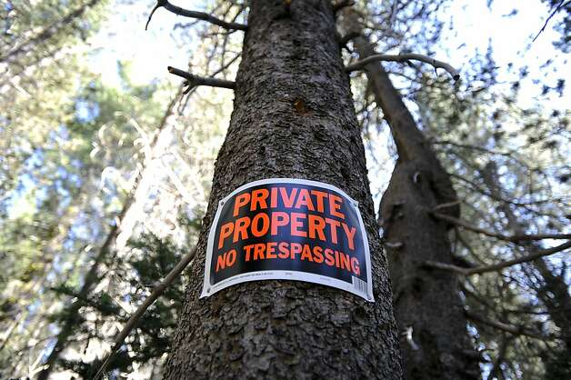 Private property signs mark the site previously scheduled for development at Donner Summit. Photo: Michael Short, Special To The Chronicle