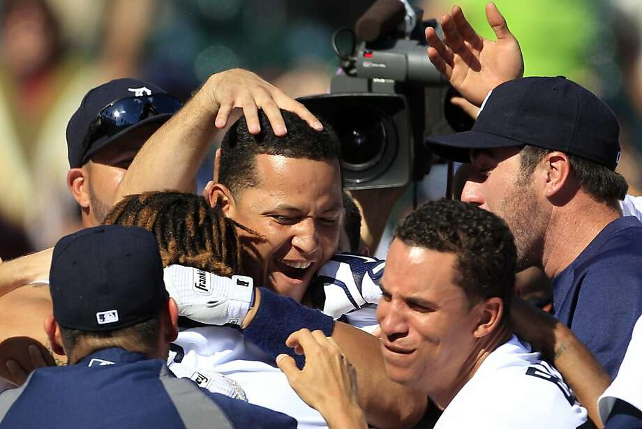 Miguel Cabrera, mobbed by teammates Photo: Carlos Osorio, Associated Press