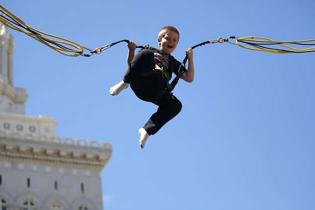 Ethan Noll, 7, flies into the air on August 5, 2012 at the Art and Soul Festival in Oakland, Calif. Photo: Megan Farmer, The Chronicle