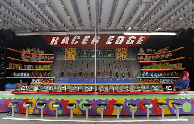 Amy Fennelly waits for customers at the Racer Edge on Sunday, August 5, 2012 at the Art and Soul Festival in Oakland, Calif. Photo: Megan Farmer, The Chronicle