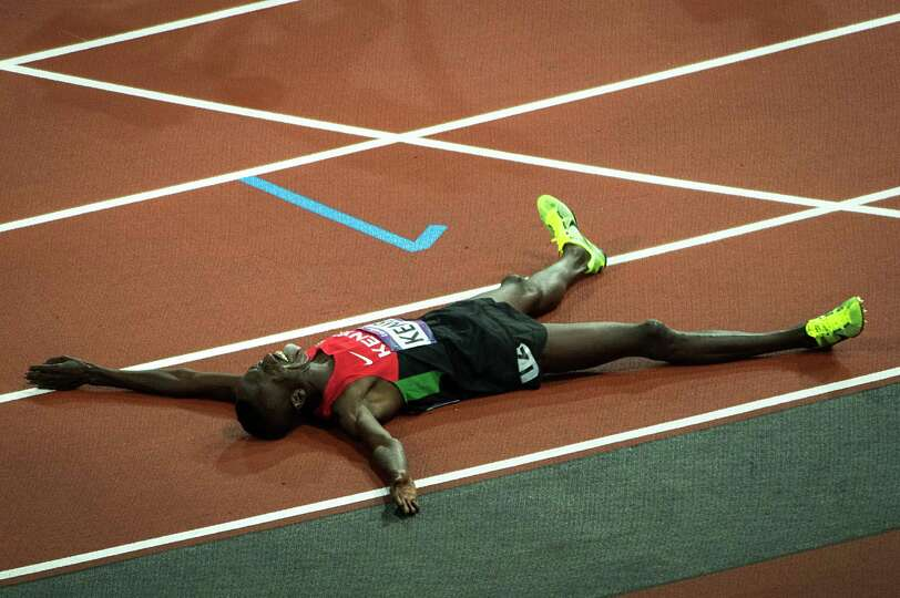 Ezekiel Kemboi of Kenya celebrates after winning the men's 3000-meter steeplechase at the 2012 Londo