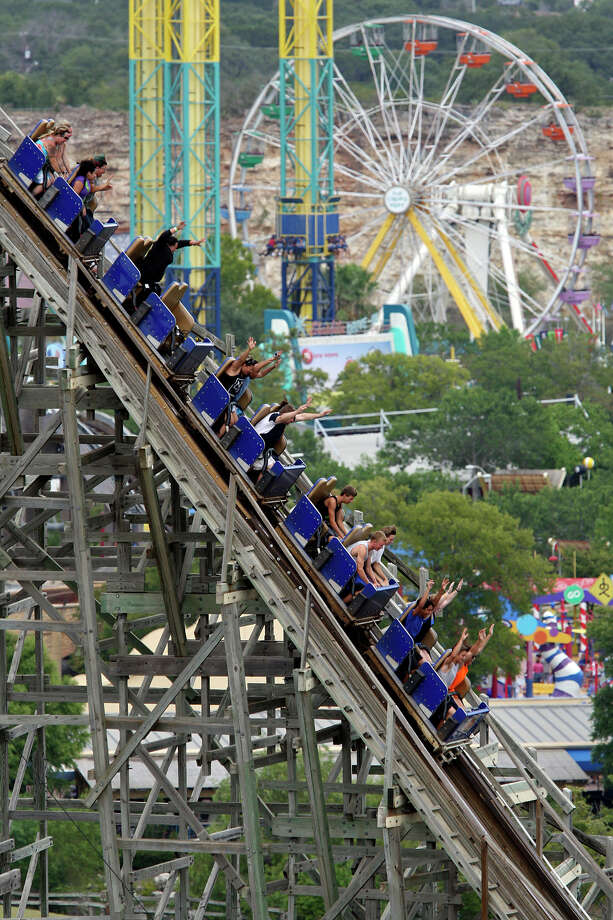 People ride the Rattler at Six Flags Fiesta Texas, Sunday, Aug. 5, 2012. The final ride for the wooden coaster was set for 9:45 Sunday night. Fiesta Texas is closing the signature ride after 20 years in operation. No plans have been announced for its replacement. Photo: Jerry Lara, San Antonio Express-News / © 2012 San Antonio Express-News