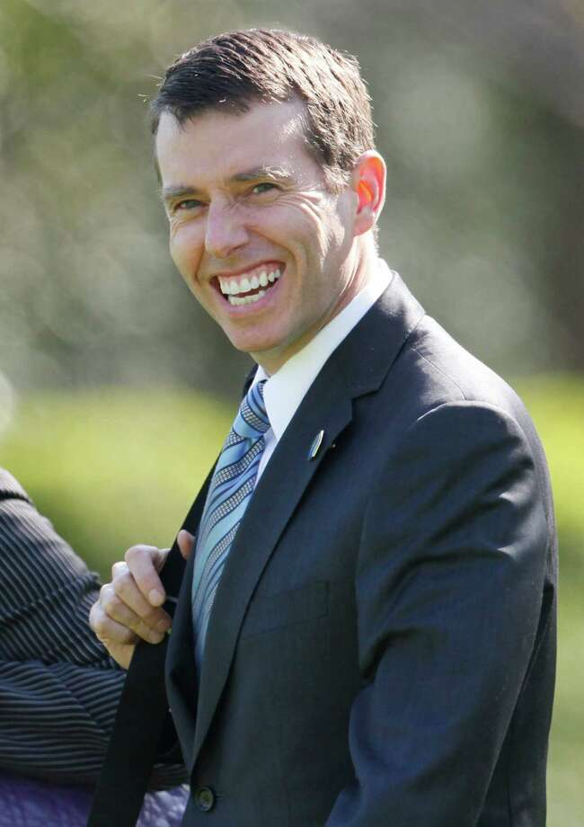 This photo taken April 14, 2011, shows senior adviser David Plouffe on the South Lawn of the White House as he accompanies President Barack Obama to Chicago. Obama's 2008 campaign manager is helping shape the president's re-election strategy from the West Wing. The Delaware native returned to Obama's side after Democrats lost control of the House in the 2010 elections and is arguably the most important person in melding Obama's policies with politics. (AP Photo/Charles Dharapak) Photo: Charles Dharapak, Associated Press / AP